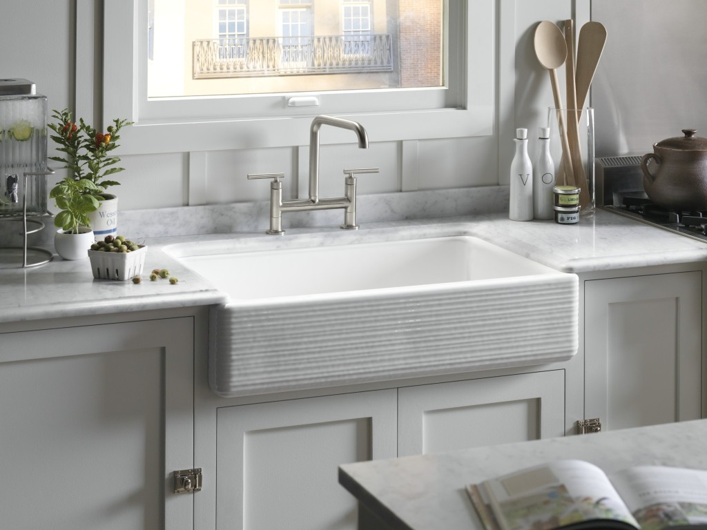 No surprise that farmhouse sinks were seen all over the showroom floor, however, they're now seen in more finishes such as fire clay and distressed granite. Kohler's version allows for an apron overhang that fits over the cabinet lip with no cutting into cabinetry.